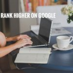 Picture displaying someone hand who is studying hard to rank higher on Google